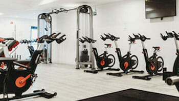 a group of exercise bikes in a gym