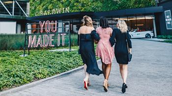 Three women walking into the C. Baldwin Hotel