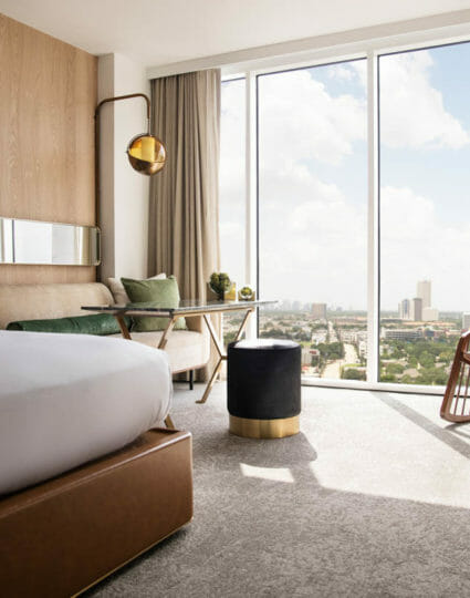 View from king bedroom with view of downtown Houston through floor to ceiling windows