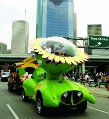 Custom green car shaped like a flower in a parade