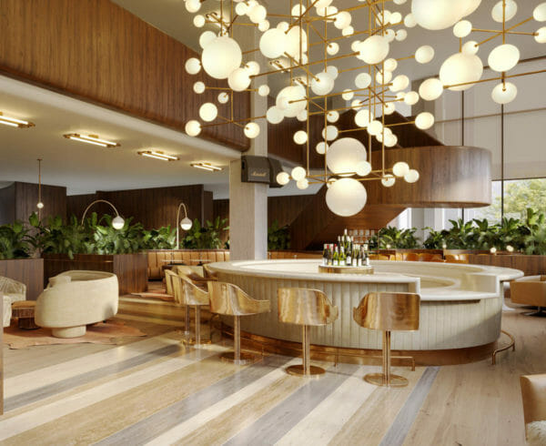 Circular bar encircled with gold bar stools and has spherical ceiling lamps
