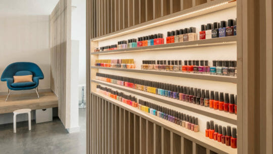 Shelves full of different colored nail polishes at Paloma Nail Salon
