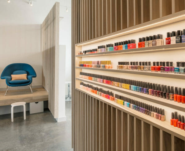 Shelves full of different colored nail polishes at Paloma Nail Salon