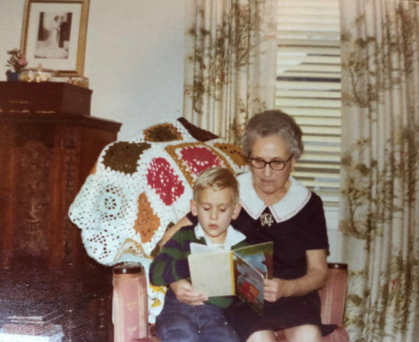 Young Chef Chris Cosentino sitting on his grandmother Rosalie's lap while she reads to him